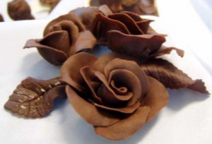 Chocolate moulded peacock, rose and boy